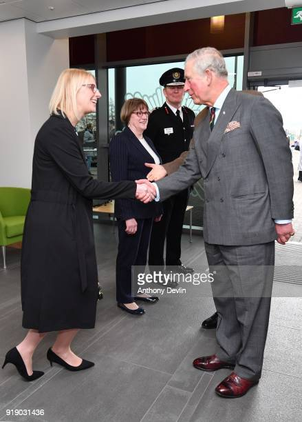 The Prince of Wales meets Clare Crabb North Regional Director of the Prince's Trust as he arrives at Dearne Community Fire Station on February 16...