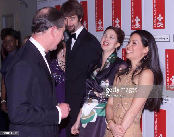 """The Prince of Wales meets Lucy Liu and Drew Barrymore, two of the stars of the new """"Charlie's Angels"""" film at the premiere in London's Leicester..."""