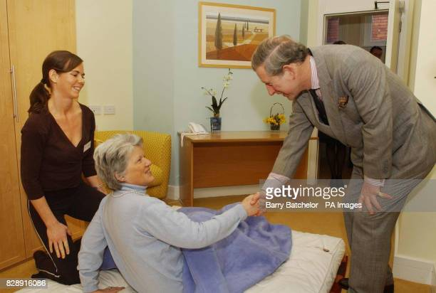 The Prince of Wales meets patient Hilary CravenSmith as therapist Olivia Edwards looks on during his visit to The Haven Trust's therapy centre for...