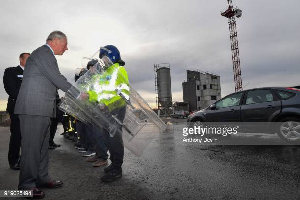 The Prince of Wales meets students following a fire and public order demonstration during a visit to Dearne Community Fire Station on February 16...