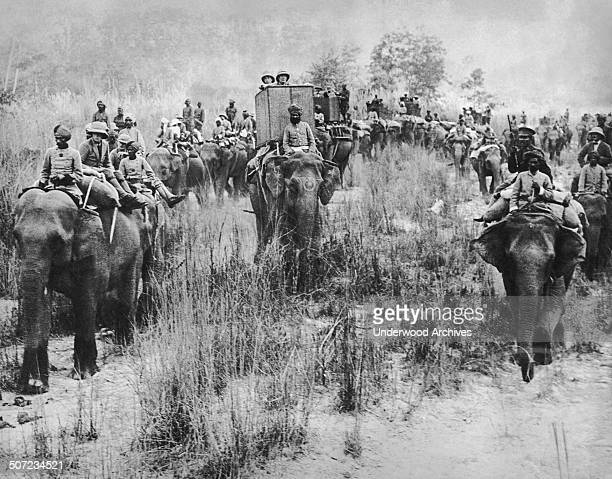 The Prince of Wales perched atop an elephant leading a tiger hunting expedition during his royal tour of India Nepal January 29 1922