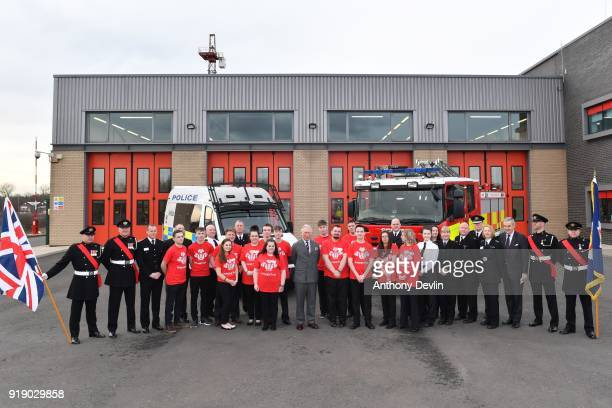 The Prince of Wales poses for a group photograph with staff and students during a visit to Dearne Community Fire Station on February 16 2018 in...