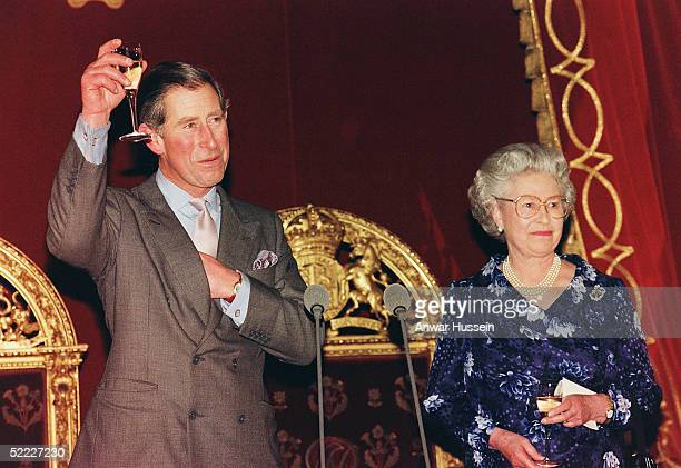 The Prince of Wales raises his glass in response to a toast from his mother, Queen Elizabeth II, during a reception in his honour on the eve of his...
