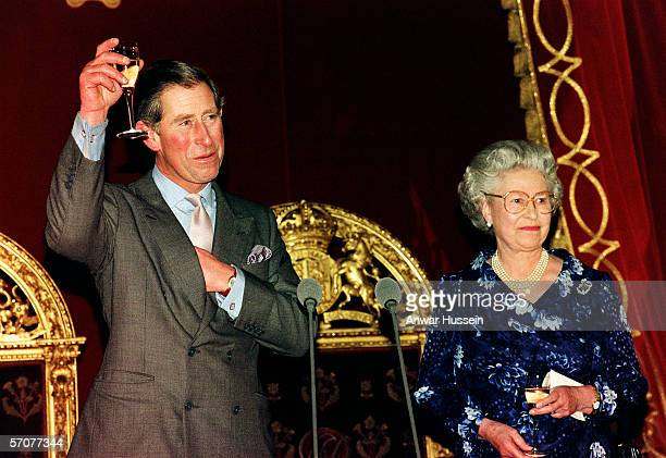 The Prince of Wales raises his glass in response to a toast from his mother, Queen Elizabeth II, at Buckingham Palace in London on November 13th,...