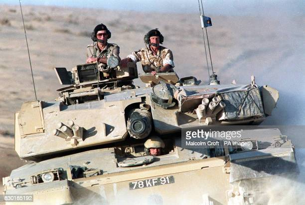 The Prince of Wales rides in a Challenger tank of the Royal Scots Dragoon Guards with Brigadier Patrick Cordingley of the 7th Brigade, while on a...