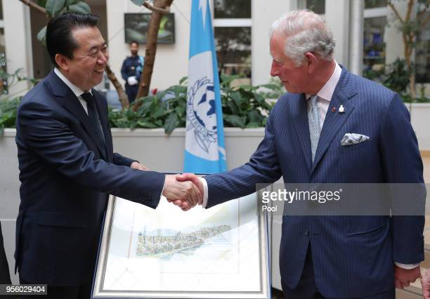 The Prince of Wales shakes hands with Interpol President Meng Hongwei during his tour of Interpol as part of his visit to France on May 8th 2018 in...