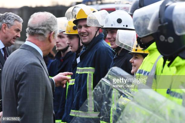 The Prince of Wales shares a laugh with students following a fire and public order demonstration during a visit to Dearne Community Fire Station on...