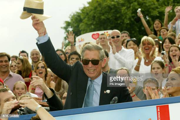 The Prince of Wales sitting next to singer Beyonce greets the crowds at the Capital Radio Party in the Park in Hyde Park London The concert is being...