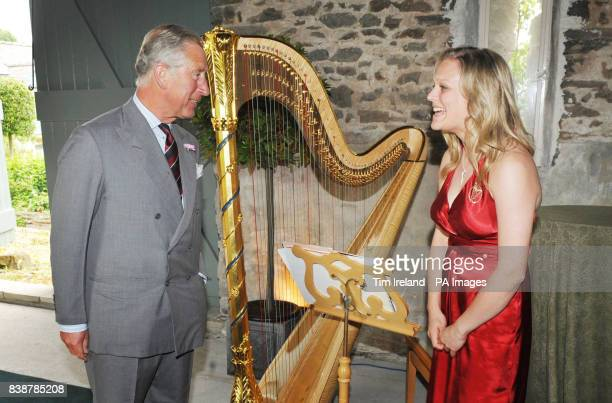 The Prince of Wales speaks with his new official harpist Hannah Stone during a reception for the Cambrian Mountain Initiative at his Welsh farm...