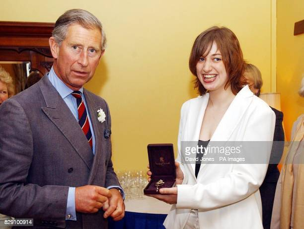 The Prince of Wales stands with his new official harpist Jemima Phillips with her 'Broach of Office' at the Great House Hotel in Laleston Jemima...