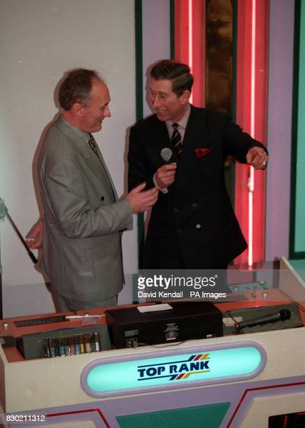 The Prince of Wales talk to Bingo caller Terry Jobson during a visit to the Top Rank Bingo Hall in Chester The Prince accepted a cheque for 75000...