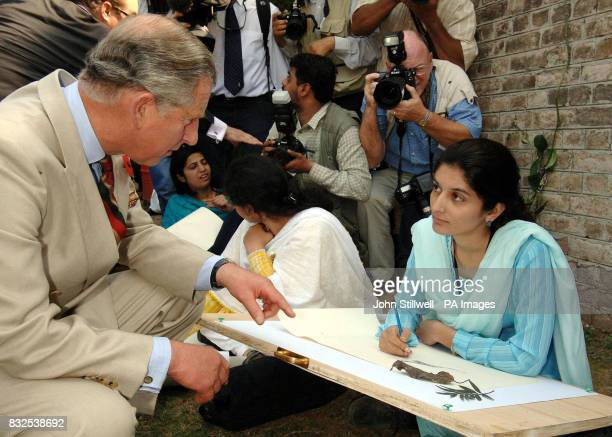The Prince of Wales talks to an art student at the Fatima Jinnah college in Rawalpindi Pakistan