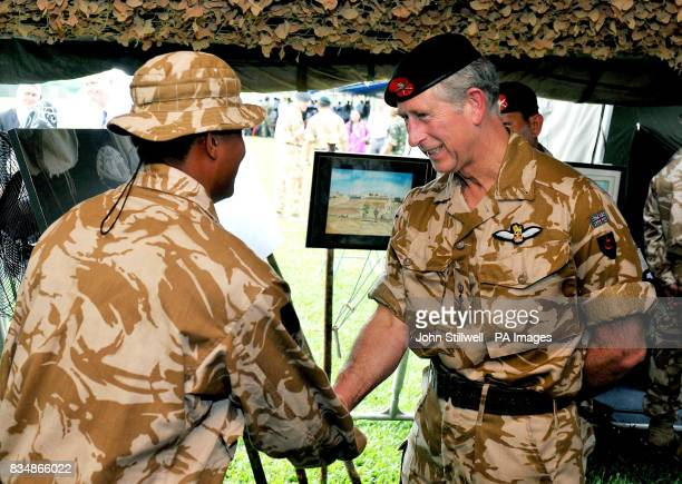 The Prince of Wales talks to Gurkha soldier Lance Corporal Bhim Garbuja who served with Prince Harry in Afghanistan during a tour of the Gurkha...