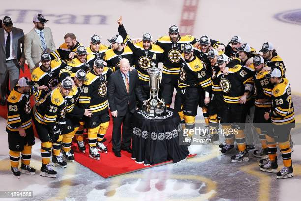 The Prince of Wales trophy is presented to the Boston Bruins by Deputy Commissioner Bill Daly after they defeated the Tampa Bay Lightning 1 to 0 in...
