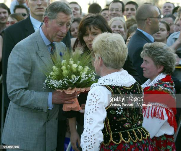 The Prince of Wales walks through the Market Square of Krakow Poland and meets members of the public on his way to Cloth Hall to attend a reception...