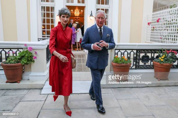 The Prince of Wales walks with the British Ambassador to Greece Kate Smith as he arrives for a reception at the British Ambassador's residence in...