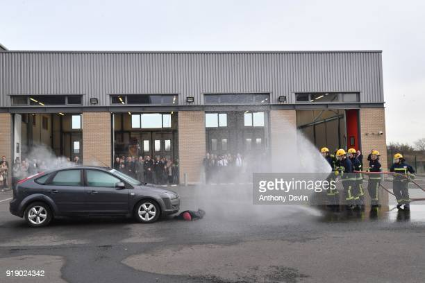 The Prince of Wales watches a fire and public order demonstration by students during a visit to Dearne Community Fire Station on February 16 2018 in...