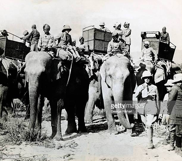 The Prince of Wales watches from the top of an elephant the completion of preparations for a hunting expedition into the jungles of Nepal on the...