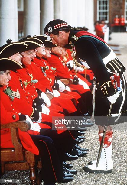 The Prince of Wales wearing a kilt chats to Chelsea Pensioners when he visits Chelsea Hospital in 1992