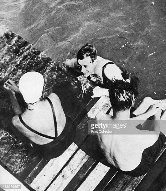 The Prince of Wales with friends on a raft the Riviera c1930s The future King Edward VIII enjoys a dip Illustration from George V and Edward VIII A...
