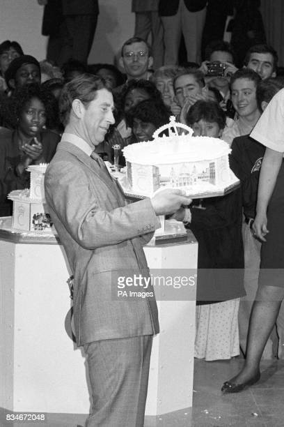 The Prince of Wales with the birthday cake made for him at a huge party to celebrate his 40th birthday today in a once derelict tramshed in Birmingham