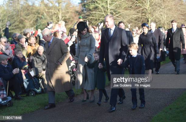 The Prince of Wales with the Duke and Duchess of Cambridge and their children Prince George and Princess Charlotte arriving to attend the Christmas...