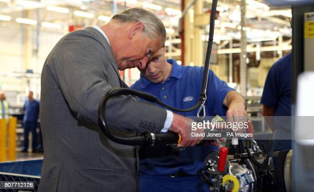 The Prince of Wales works on a turbocharger assisted by Anthony Hookings at the Ford engine plant near Bridgend south Wales Charles begins a lengthy...