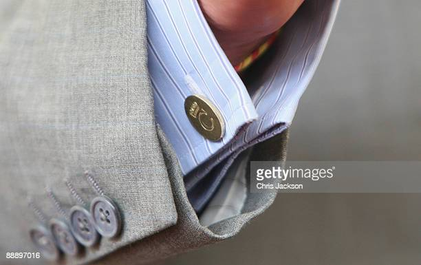 The Prince of Wales's gold cufflinks are seen during a visit by HRH Prince Charles, Prince of Wales's to St Pancras Almshouses on July 8, 2009 in...