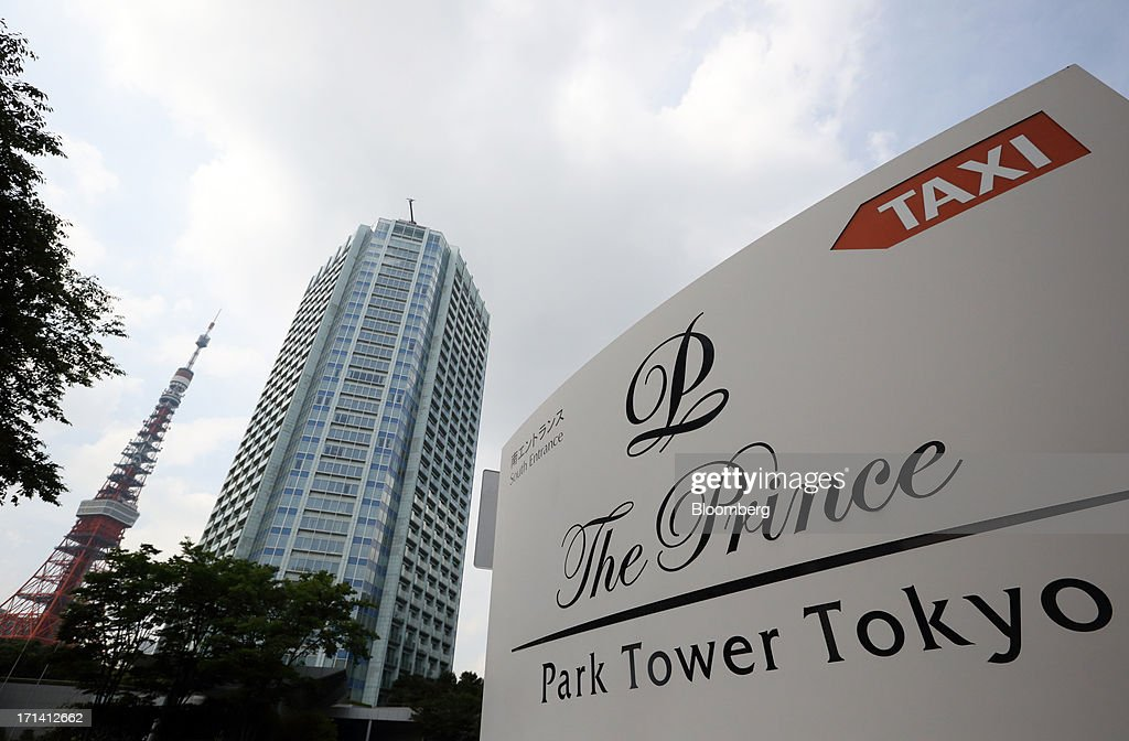 The Prince Park Tower Tokyo, operated by Prince Hotels Inc., center, stands behind its signage in Tokyo, Japan, on Monday, June 24, 2013. Cerberus Capital Management LP is battling Seibu Holdings Inc. shareholders including Yoshiaki Tsutsumi, once the world's richest man, for seats on the Japanese company's board. History suggests the investment company, run by Stephen A. Feinberg, will fail. Photographer: Tomohiro Ohsumi/Bloomberg via Getty Images