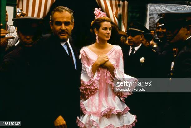 The prince Ranieri III attending the Seville Fair with his wife the American actress Grace Kelly The woman wears a typical Sevillian costume Seville...