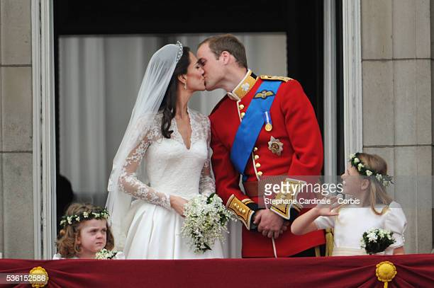 The Prince William of Wales kisses his new bride Catherine Elizabeth 'Kate' on the balcony of Buckingha m Palace The Prince and Princess of Wales...