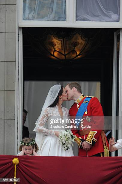 """The Prince William of Wales kisses his new bride Catherine Elizabeth """"Kate"""" on the balcony of Buckingha m Palace. The Prince and Princess of Wales..."""
