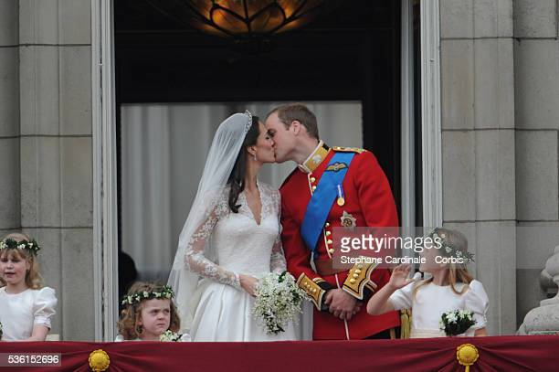 "The Prince William of Wales kisses his new bride Catherine Elizabeth ""Kate"" on the balcony of Buckingha m Palace. The Prince and Princess of Wales..."