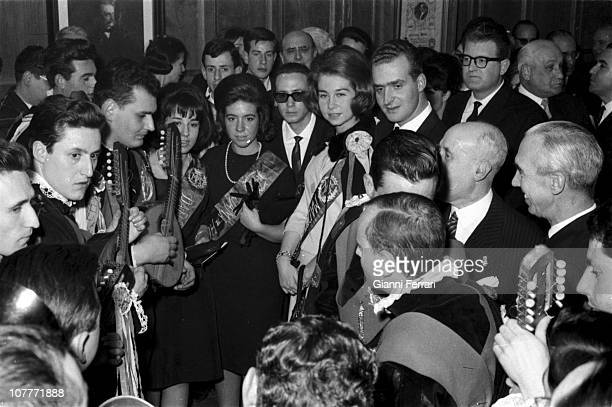 The princes Juan Carlos of Borbon and Sofia of Greece at a party surrounded by the tuna traditional music group formed by university students Madrid...