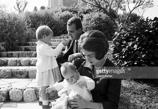 The princes Juan Carlos of Borbon and Sofia of Greece in the gardens of the Zarzuela Palace with their daughters Elena and Cristina Madrid Spain