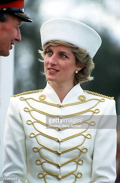 The Princes of Wales attending a passing out parade at Sandhurst April 1987 She is wearing a military style suit by Catherine Walker and hat by...