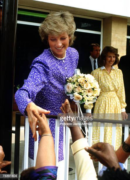 The Princes of Wales meeting the public while opening a new police station in Brixton July 1987 She is wearing an outfit by Jacques Azagury
