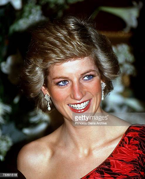 The Princes of Wales, wearing a red and black Catherine Walker evening dress, attending a dinner at the British Embassy in Paris during an official...