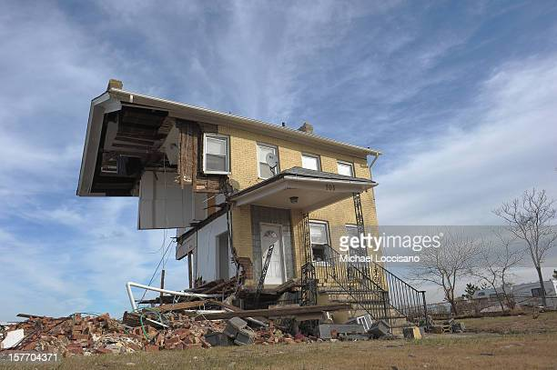 The Princess Cottage Inn victimized by Superstorm Sandy a month prior remains devastated on December 5 2012 in Union Beach New Jersey With a...