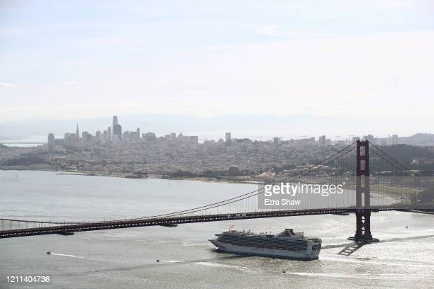 The Princess Cruises Grand Princess cruise ship heads under the Golden Gate Bridge to a port in Oakland CA on March 09 2020 as seen from the Marin...