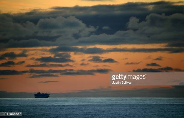 The Princess Cruises Grand Princess cruise ship sits off the coast of San Francisco as it takes on supplies on March 07 2020 in San Francisco...