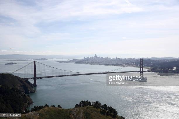 The Princess Cruises Grand Princess cruise ship travels under the Golden Gate Bridge in the San Francisco Bay to a port in Oakland, CA on March 09,...