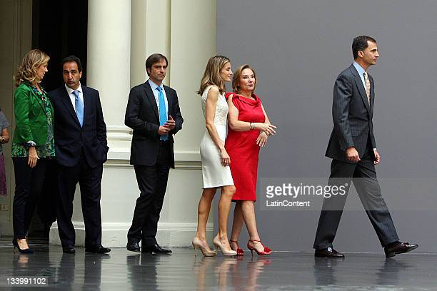 The Princess of Asturias Felipe de Borbon and Letizia Ortiz with Chile's first lady Cecilia Morel attend the inauguration of a photographic...