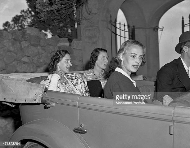 The Princess of England Margaret Countess of Snowdon and Queen of United Kingdom Elizabeth II's sister visiting the island on a car with her...
