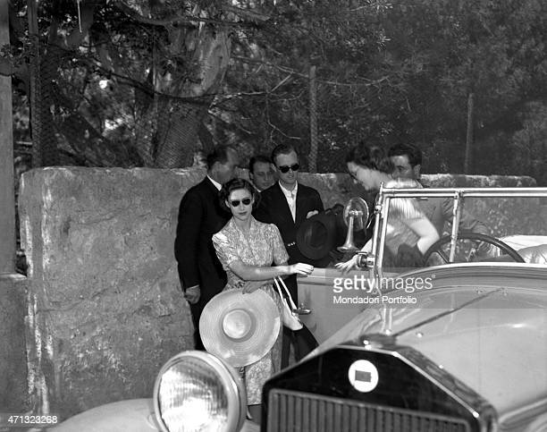 The Princess of England Margaret Countess of Snowdon and Queen of United Kingdom Elizabeth II's sister getting off a car Capri 1949