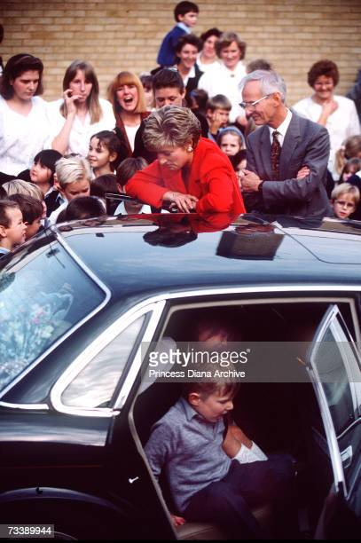 The Princess of Wales allows pupils to play in her car during a visit to the Queensway Primary School in Banbury Oxfordshire October 1991