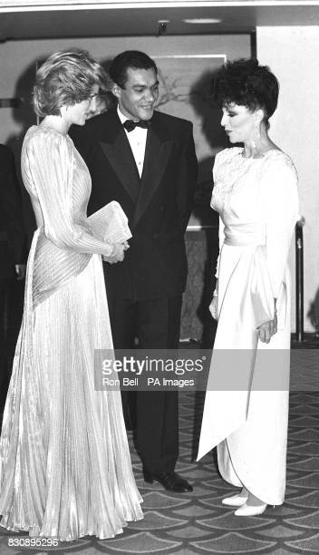 The Princess of Wales and Bruce Oldfield greet actress Joan Collins at a fashion show in aid of Dr Banardo's Grosvenor House Hotel London