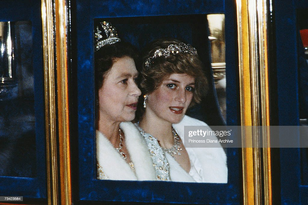 The Princess of Wales and the Queen attend the Opening of Parliament in London, November 1982. Diana is wearing a white fur coat and the Spencer tiara.