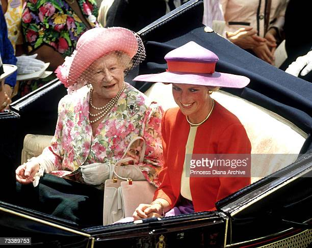 The Princess of Wales and the Queen Mother in an opentopped landau on their way to the Royal Ascot race meeting June 1990 The Princess wears a...