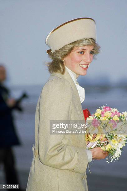 The Princess of Wales arrives at East Midlands airport for a visit to Derby wearing a coat designed by Caroline Charles 19th February 1985